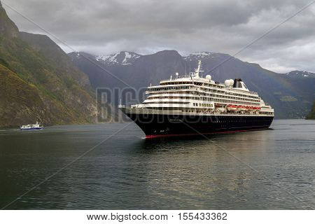"""SOGNEFJORD, NORWAY - JULY 3, 2016: A ship """"Prinsendam"""" makes a cruise on one of the largest fjords in the world."""