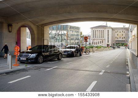 BRUSSELS BELGIUM - SEP 1 2015: Mercedes-Benz luxury limousines parked on Mont des Arts street next to the Mont des Arts park in central belgium next to the KWINT restaurant