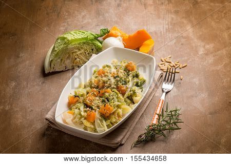 sauteed vegetables with  pumpkins  savoy cabbage and pine nuts