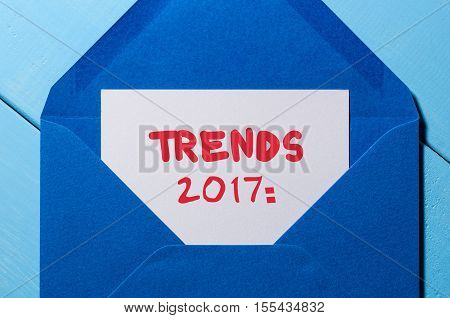 Trends 2017 banner - text written in vintage letter at blue envelope. New year concept.