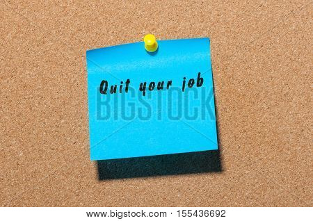 Quit your job - inscription on blue sticker pinned at notice board. New life challenge.