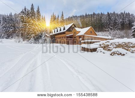Wooden Houses On Austrian Mountains At Winter