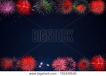 Frame of beautiful celebration golden red purple green sparkling fireworks. Independence Day 4th of July holidays salute. Christmas New Year beautiful fireworks. Holidays background.