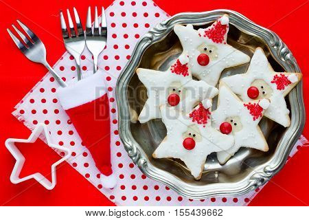 Christmas baking background - beautiful festive Christmas cookie decorated with icing. Cookies in the form of Santa Claus Xmas dessert