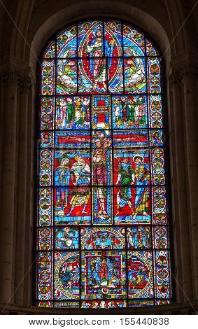 Poitiers France - September 12 2016: The ancient cathedral church in Poitiers in France - stained glass window depicting the crucifixion of Christ