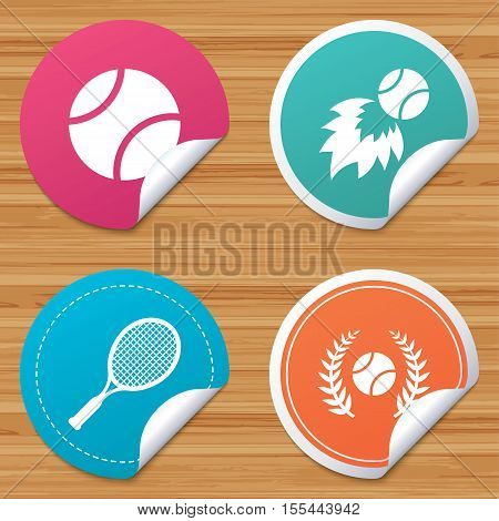 Round stickers or website banners. Tennis ball and racket icons. Fast fireball sign. Sport laurel wreath winner award symbol. Circle badges with bended corner. Vector