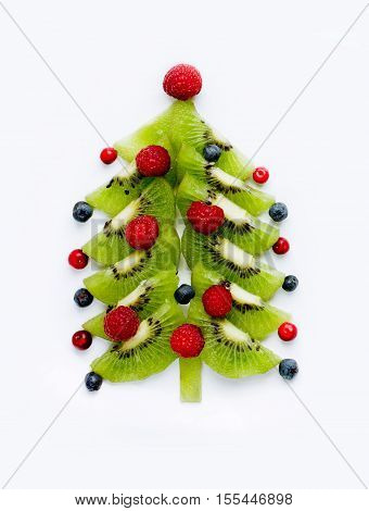 Fruit and berry Christmas tree isolated on white background
