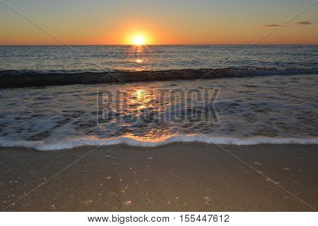 sunset on the sea beach in the calm