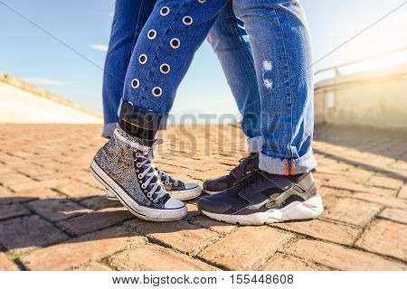 Young couple in love standing close to each other - Couple's legs in jeans - Lifestyle, love and people concept