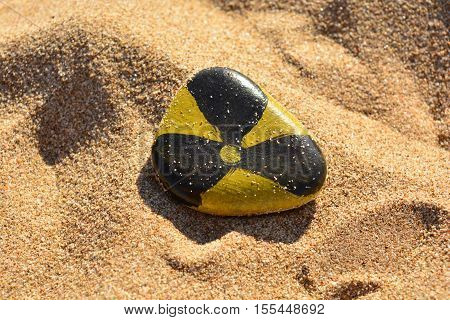 Radiation sign painted paints on a stone