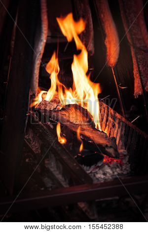 Barbecue fire grill with cooking salmon fish outdoor selective focus
