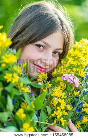 Portrait of a girl with flowers in the garden