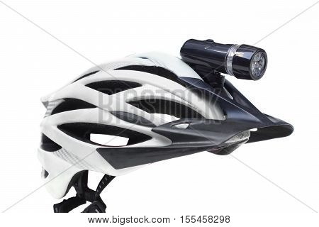 Bicycle LED torch for night riding installed on a mountain bike helmet isolated