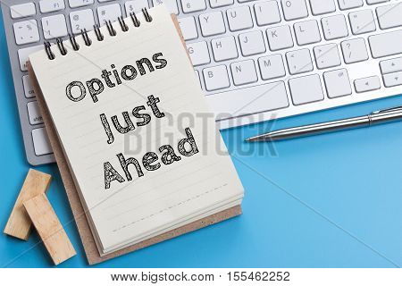 Word text Options just ahead on white paper on office table / business concept
