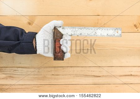 Hand In Glove Holding Iron Ruler