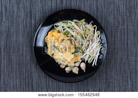 """Fried oyster with bean sprouts and shallot as """"Hoi Tod"""" in Thai served with chili sauce is popular seafood in street food and restaurant."""