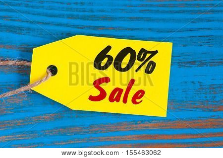 sale minus 60 percent. Big sales sixty percents on blue wooden background for flyer, poster, shopping, sign, discount, marketing, selling, banner, web