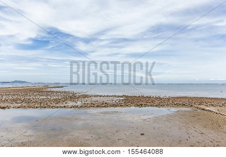 Tranquil view of beautiful nature beach and boats on background.