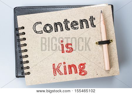 Content is king, Text message on brown Notebook / business concept