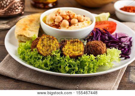 fresh falafel balls served with salad and hummus.