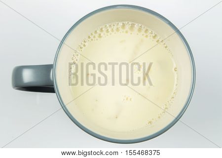 top view of glass milk. Glass of Milk From Above. Soybean milk. gray tone, Top view
