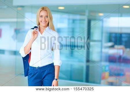 Young beautiful businesswoman standing in business center