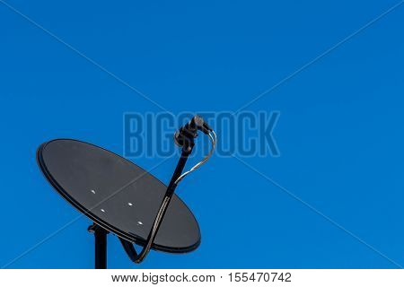 Consumer KU band satellite dish on rooftop.