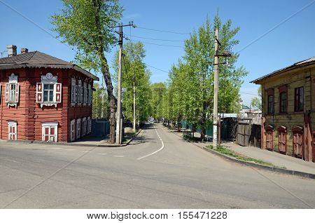 Old Street With Wooden Houses In Historical Center Of Irkutsk