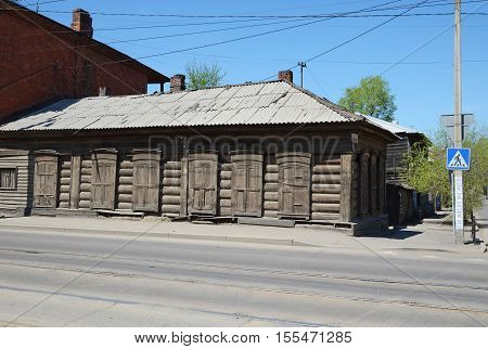 Old Wooden House With Shutters In The City Of Irkutsk