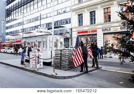 BERLIN, GERMANY- December 14, 2014 : Checkpoint Charlie. Former bordercross in Berlin on December 14, 2014. Berlin Wall crossing point between East and West Berlin during the Cold War. BERLIN, GERMANY