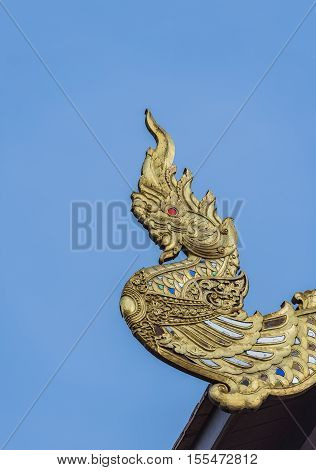 Naga statue on church roof,Naga building in thailand.