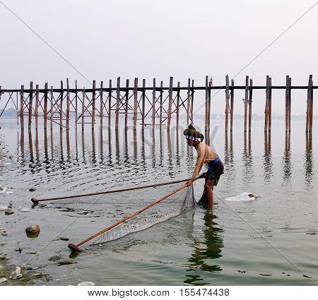 Man Catching Fish On Lake In Mandalay, Myanmar