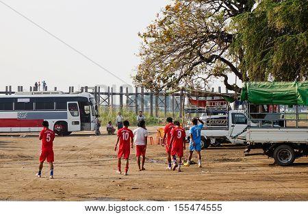 People Walking On Rural Road