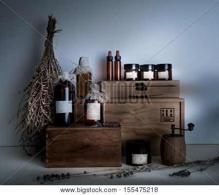 pharmacy. bottles, jars, dried wormwood bouquet on wooden shelves