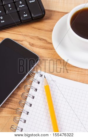 Mobile Phone With Notepad For Writing Notes And Cup Of Coffee