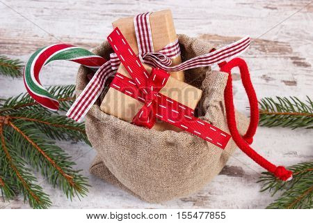Gifts For Christmas Or Valentines In Jute Bag And Spruce Branches
