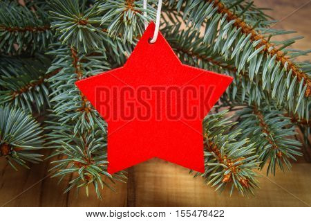 Spruce Branches And Red Wooden Star With Copy Space For Text