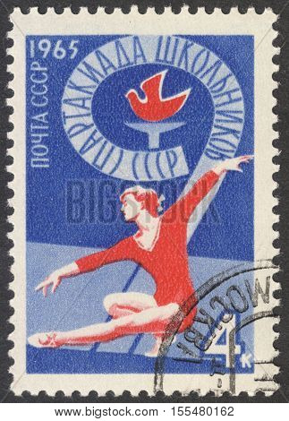 MOSCOW RUSSIA - CIRCA OCTOBER 2016: a post stamp printed in the USSR shows a gymnast the series