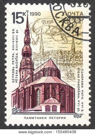 MOSCOW RUSSIA - CIRCA OCTOBER 2016: a post stamp printed in the USSR shows the St. Peter's church on the background of ancient Riga the series