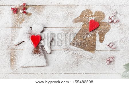 Christmas Gingerbread Angels On A Wooden Background.