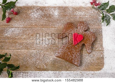 Christmas Gingerbread Angel On Wooden Background.