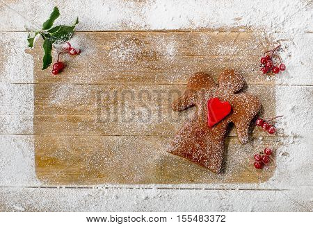 Christmas Gingerbread Cookies On A Wooden Background.