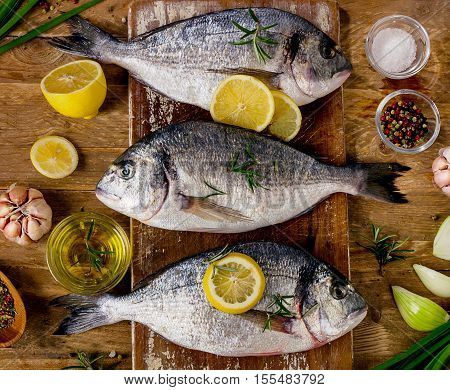 Fresh Fish With Spices  On A Wooden Background. Healthy Food Concept.