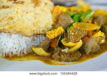 Thai Style Food : Omelet With Rice And Spicy Curry Beef