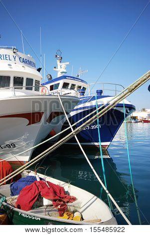 CALETA DE VELEZ, SPAIN - OCTOBER 27, 2008 - Fishing trawlers moored in the harbour Caleta de Velez Malaga Province Andalusia Spain Western Europe, October 27, 2008.