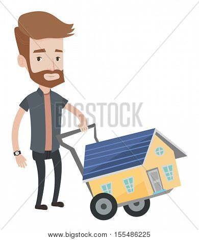Caucasian hipster man with beard pushing a trolley with a house. Young smiling man buying home. Man using trolley to transport house. Vector flat design illustration isolated on white background.