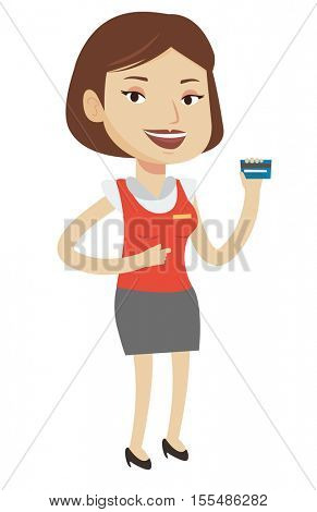 Caucasian female cashier holding credit card. Happy female cashier at work. Smiling cashier pointing with her finger at credit card. Vector flat design illustration isolated on white background.