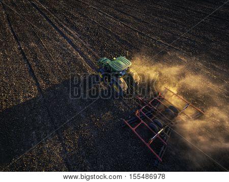 Aytos Region Bulgaria - September 05 2016: A modern John Deere 6115R tractor on a field.The 6115R has Premium ComfortView cab.Full Frame design 2.580 m wheelbase and 4.5 l DieselOnly PowerTech PVX engine