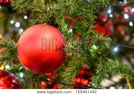 Christmas Tree Decoration with toys new year, bauble and lights