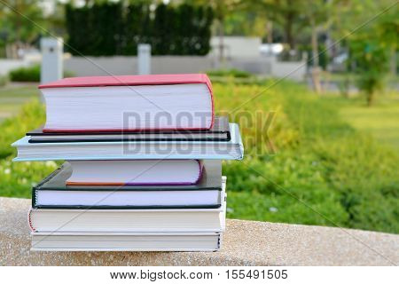 Stack of books in the nature park